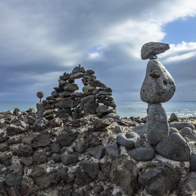 """Rock Sculpture on a beach"" stock image"