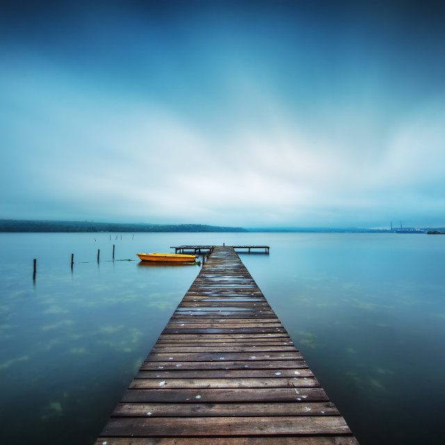 """Small Dock and Boat at the lake"" stock image"