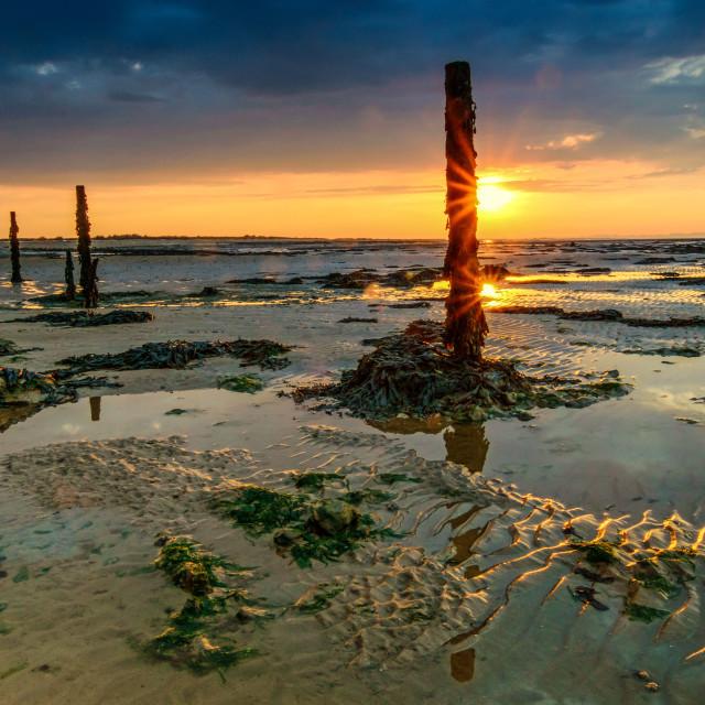 """Naze Beach Double Sunset"" stock image"