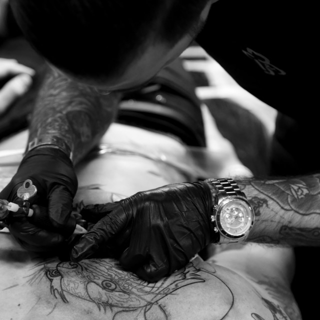"""Tattooist Chris Stockings"" stock image"