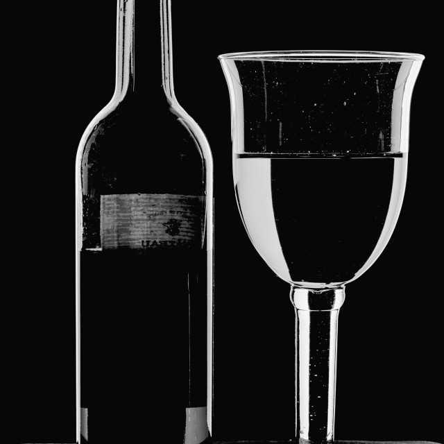 """""""Bottle and Glass - high key monochrome."""" stock image"""
