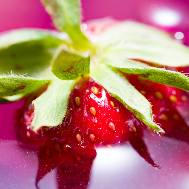 """""""Close up of a strawberry flotting in drink"""" stock image"""