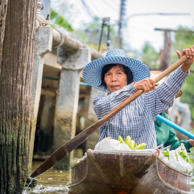 """Asian woman selling goods at a traditional Asian floating market near..."" stock image"
