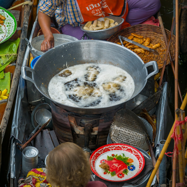 """""""Asian woman selling goods at a traditional Asian floating market near..."""" stock image"""