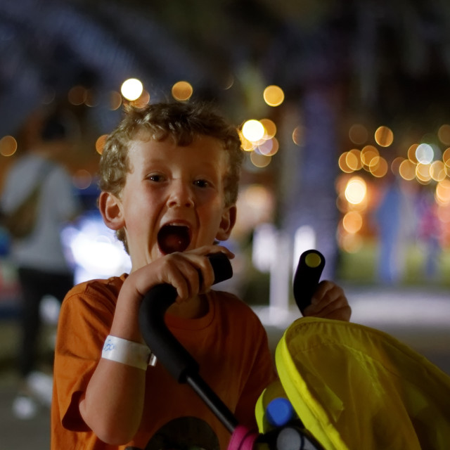 """""""Small Boy with Big Smile at Abu Dhabi's MOTN (Mother of the Nation) Festival"""" stock image"""