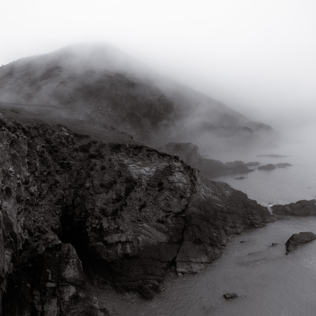 """Sea mist over cliffs"" stock image"