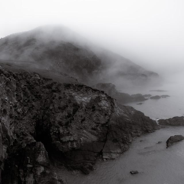 """Sea mist over cliffs"" stock image"