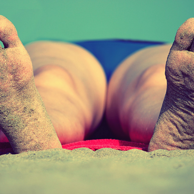 """Close-up of the feet of a sleeping woman"" stock image"