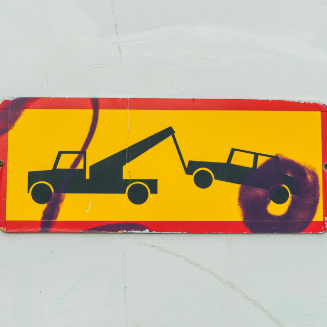 """Sign of a truck removing a car"" stock image"