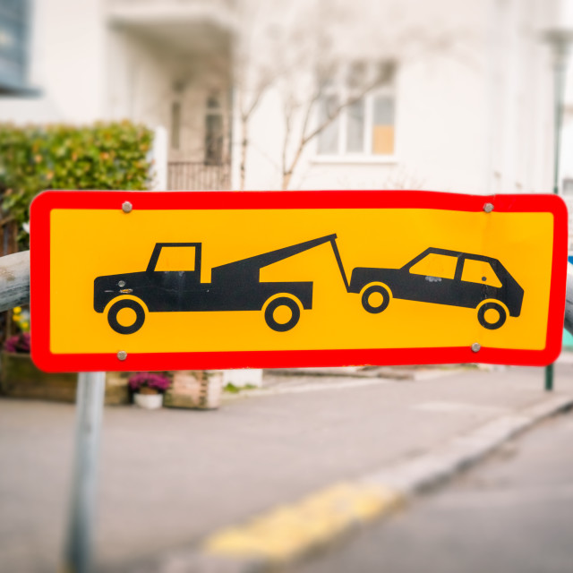 """Street sign of a car being removed"" stock image"