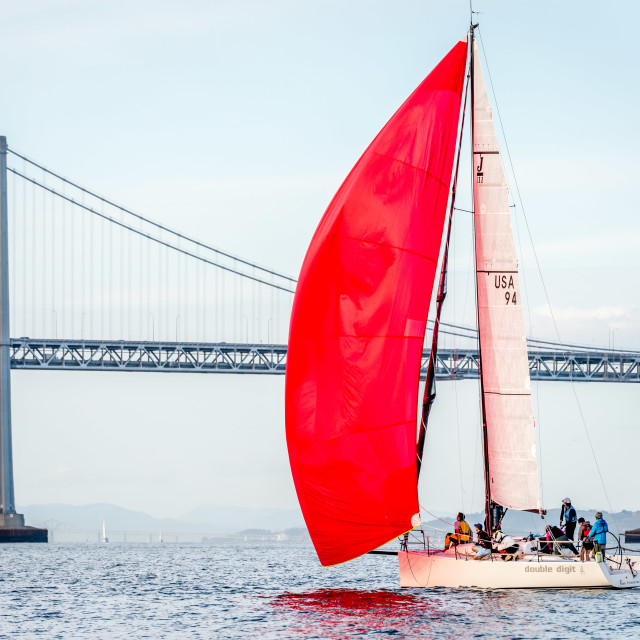 """Red Spinnaker, San Francisco Bay Bridge"" stock image"