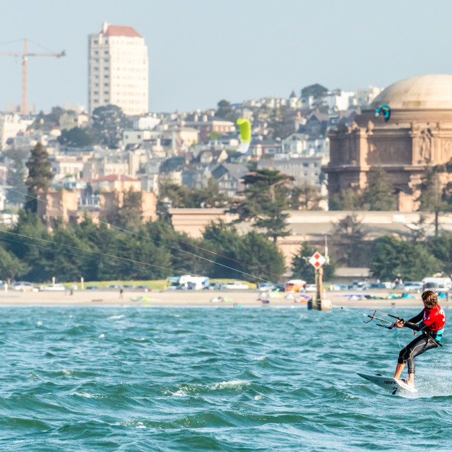 """""""Foiling Kiteboarder with Crissy Fields beach and Palace of Fine Art"""" stock image"""