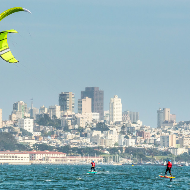 """Foiling Kiteboarders race across San Francisco Bay"" stock image"