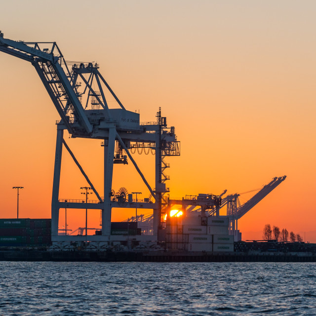 """Sunrise, Cargo Cranes, Port of Oakland."" stock image"
