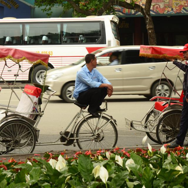 """Cyclo tuk tuk drivers in Hanoi, Vietnam"" stock image"