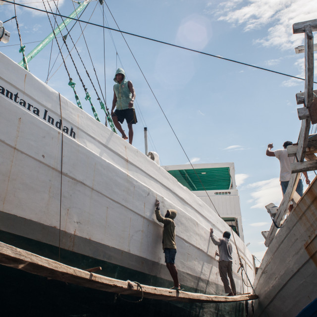 """""""Workers at Paotere Port, Makassar"""" stock image"""