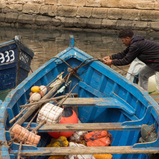 """""""Fisherman and his boat, Port of Essaouri, Morocco"""" stock image"""