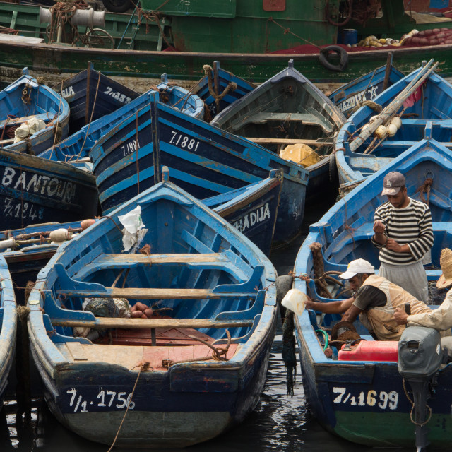 """""""Fisherman and their boats, port of Essaouira, Morocco"""" stock image"""