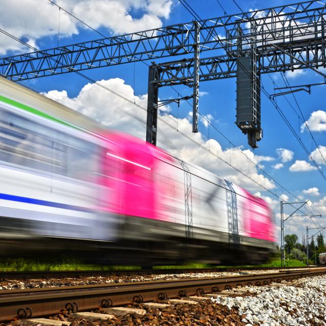 """Modern electric passenger train moving on full speed"" stock image"