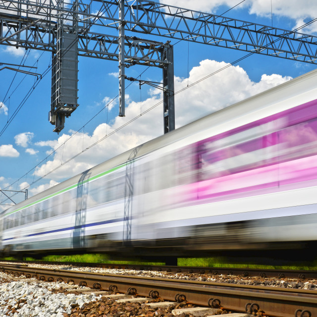 """Modern electric passenger train moving on full speed"" stock image"