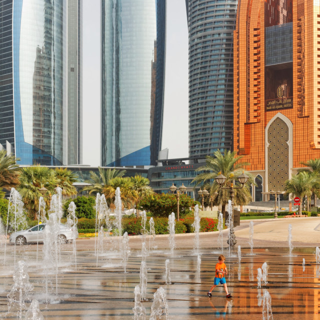 """""""Small Boy Playing in Fountains on Abu Dhabi's Corniche"""" stock image"""