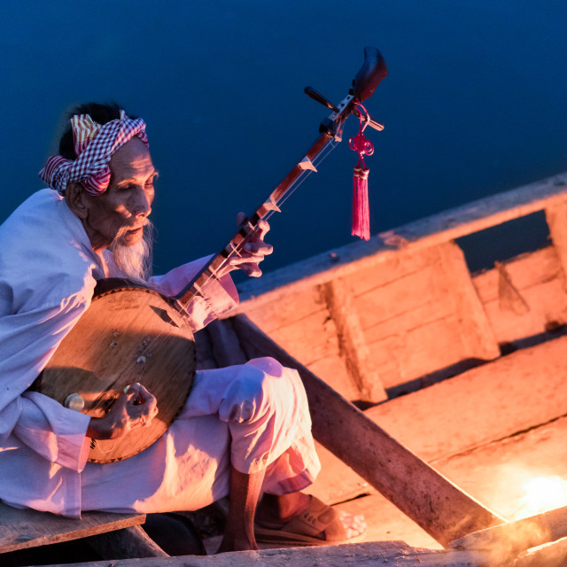 """Playing traditional zither on the river"" stock image"
