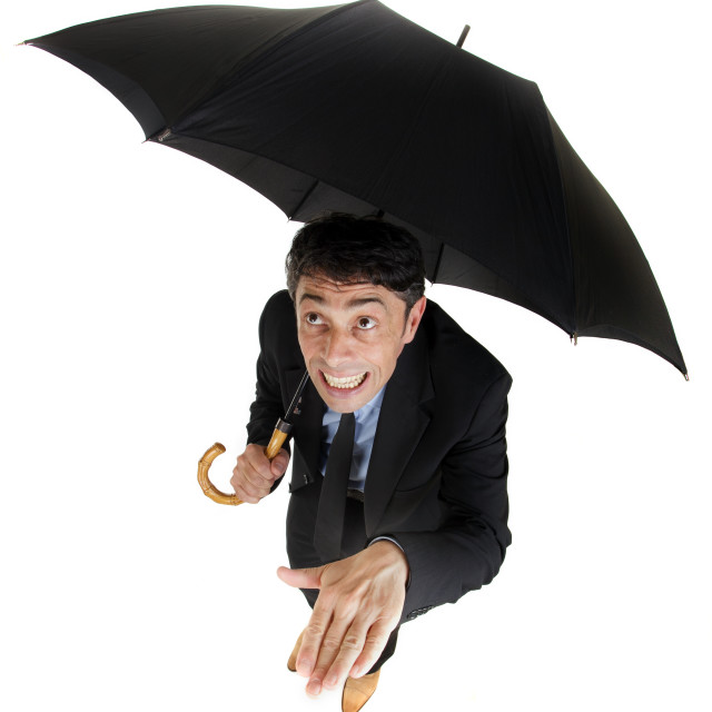"""Businessman checking on the rain"" stock image"