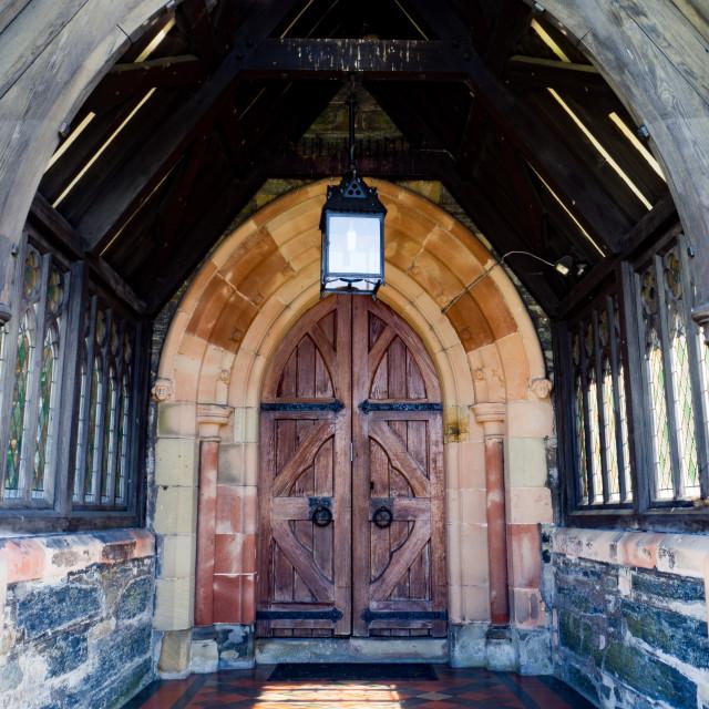 """St. Trillo's Church doorway"" stock image"