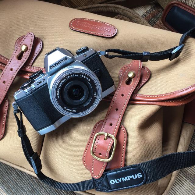 """""""Olympus camera and Billingham bag"""" stock image"""