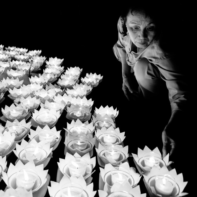 """A woman arrange the flower lanterns !"" stock image"