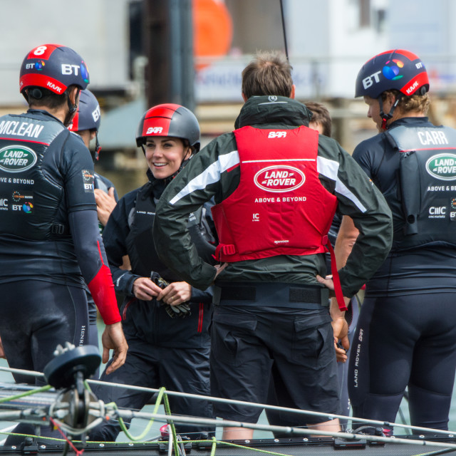 """Duchess chatting with BAR Racing crew members"" stock image"
