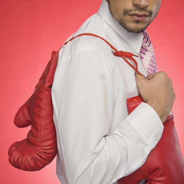 """Businessman holding boxing gloves"" stock image"
