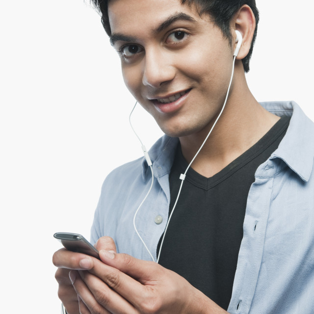 """""""Portrait of a man listening to music on iPod"""" stock image"""