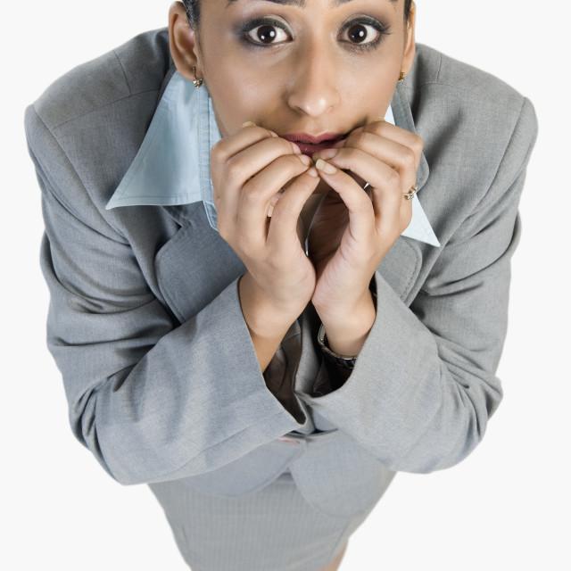 """Businesswoman looking terrified"" stock image"