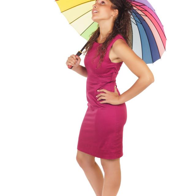 """woman holding rainbow umbrella"" stock image"