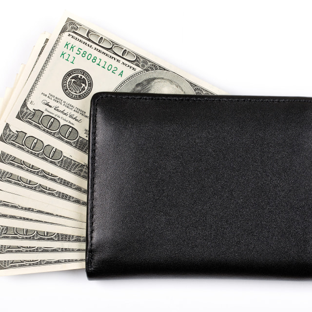 """Black wallet with American dollars"" stock image"