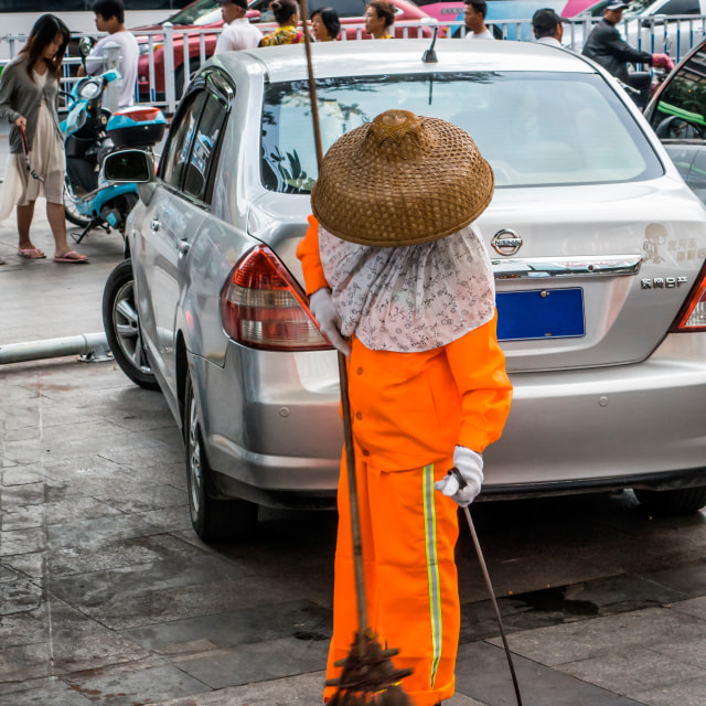 """""""Woman in Eastern dress, sweeping the street"""" stock image"""