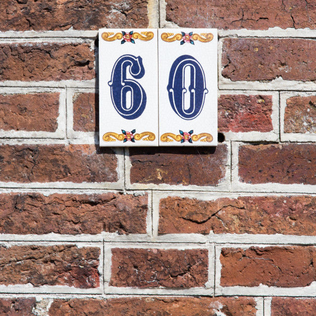 """House number on a red brick wall in the Netherlands"" stock image"