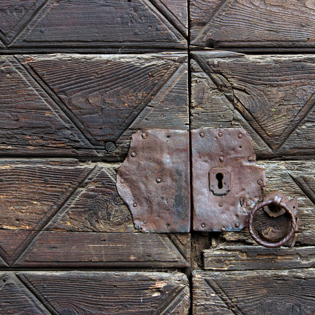 """""""Detail of an old wooden doorway with knocker"""" stock image"""