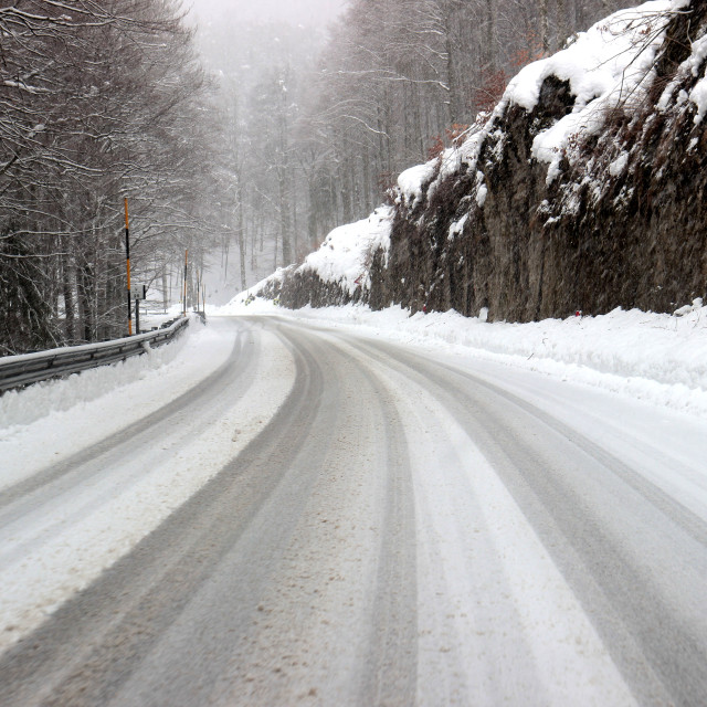 """Mountain road covered by snow"" stock image"