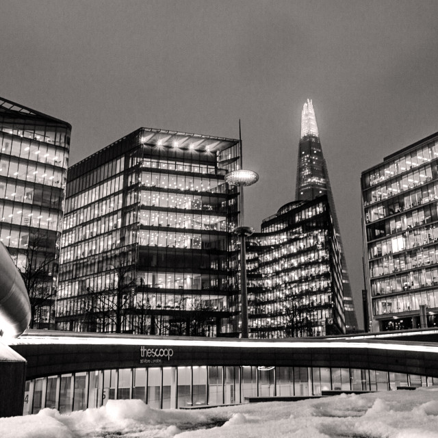 """""""The Scoop - More London with snowfall at Night"""" stock image"""