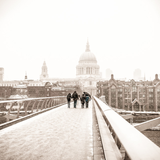 """""""St Paul's Cathedral in snow on Millennium Bridge"""" stock image"""