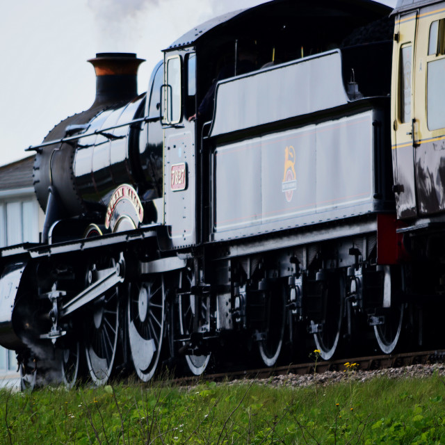 """Lydham Manor 7827 steam engine above beach huts at Goodrington, Torbay, Devon, England"" stock image"