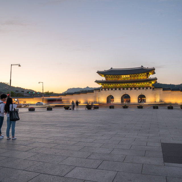 """Tourist take photo of Gwanghwamun Gate, Gyeongbokgung Palace in Seoul, South Korea during sunset."" stock image"