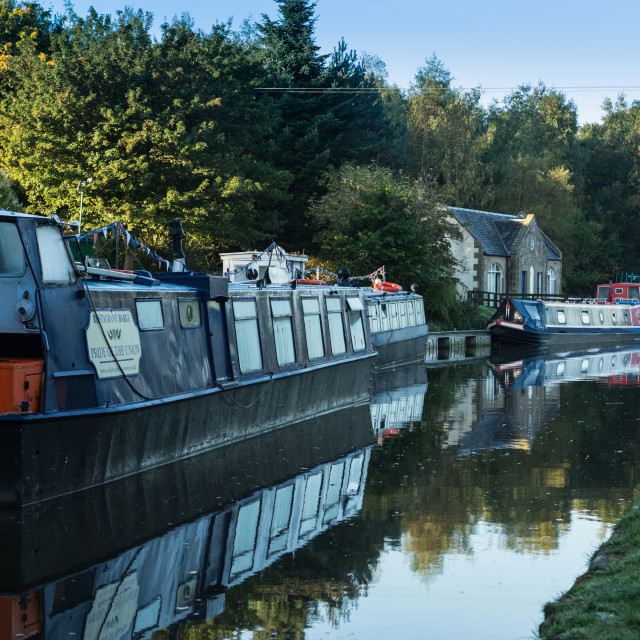 """""""Longboats in a row on the Union Canal in Ratho Village"""" stock image"""