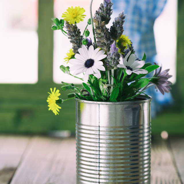 """""""Tin can used as a vase with flowers"""" stock image"""