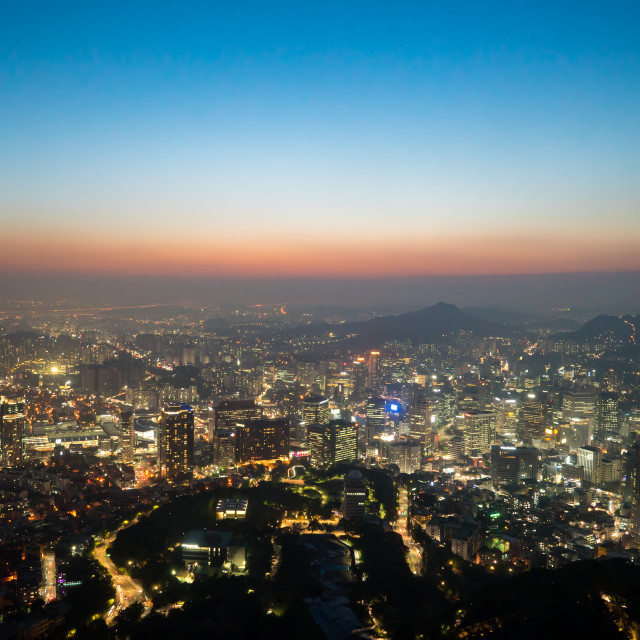 """View of downtown cityscape and city slyline in Seoul, South Korea during sunset"" stock image"