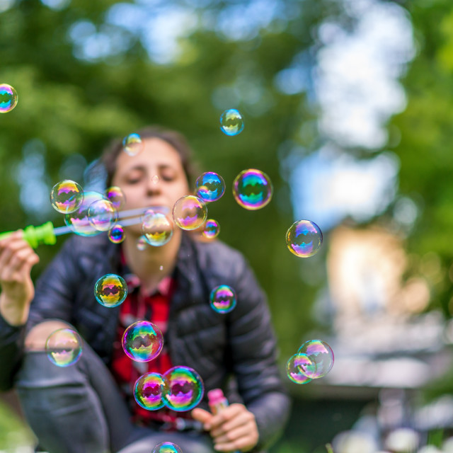 """beautiful young woman blowing bubble outdoor happy lifestyle"" stock image"