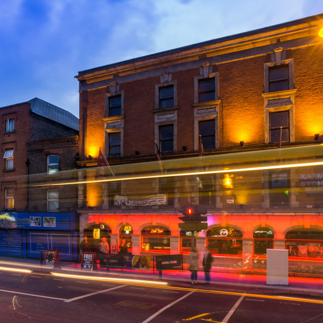 """The city of Dublin in Ireland is alive at dusk as citizens and tourists look for places to eat and drink. These long exposure shots show the life of the city."" stock image"