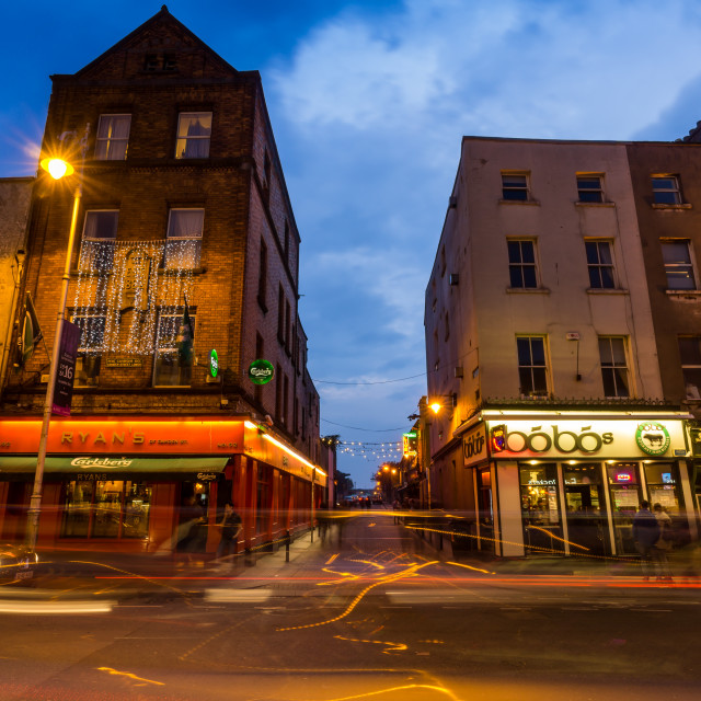 """""""The city of Dublin in Ireland is alive at dusk as citizens and tourists look for places to eat and drink. These long exposure shots show the life of the city."""" stock image"""